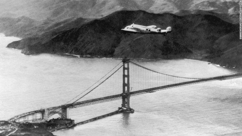 The Lockheed Electra 'Flying Laboratory', piloted by American aviator Amelia Earhart (1898 - 1937) and Fred Noonan flies over the Golden Gate bridge in Oakland, California, at the start of a planned round-the-world flight, 17th March 1924. The trip had to be abandoned after the plane crashed on take off in Hawaii. A subsequent attempt ended when the aviators went missing in the Pacific and the pair were eventually presumed dead. (Photo by Keystone/Hulton Archive/Getty Images)